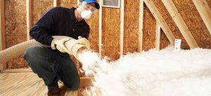 Roofing Contractor Installing Blown-In Insulation